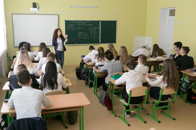 Students in classroom at lesson stock photos