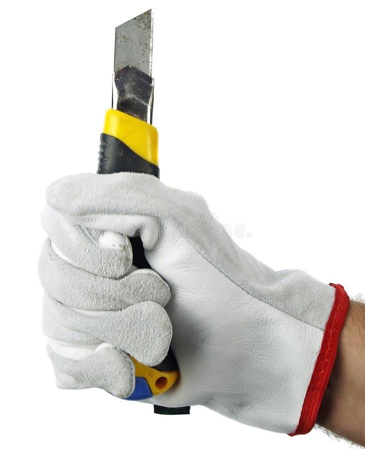 Luva de trabalho isolada da bruxa da mão que guardara a faca de corte fotos de stock royalty free