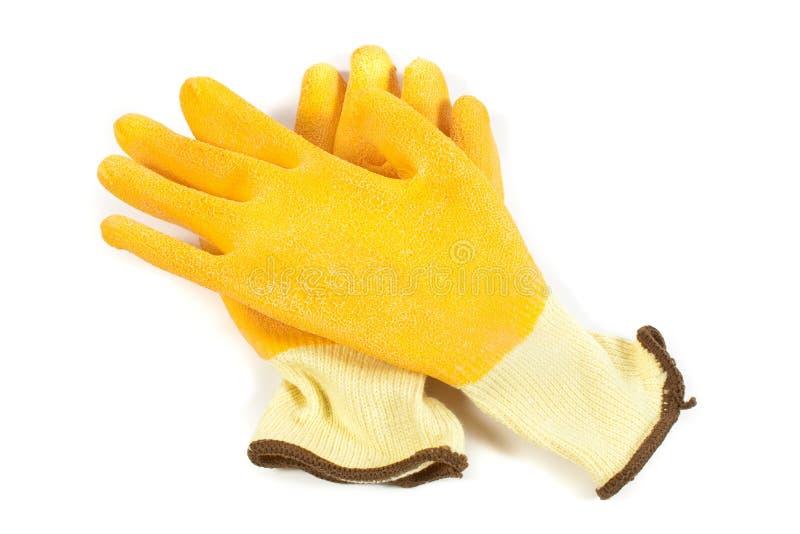 Luvas amarelas industriais do trabalho isoladas fotografia de stock