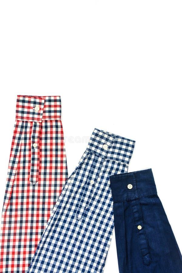 Luvas das camisas de manta isoladas no fundo branco fotos de stock