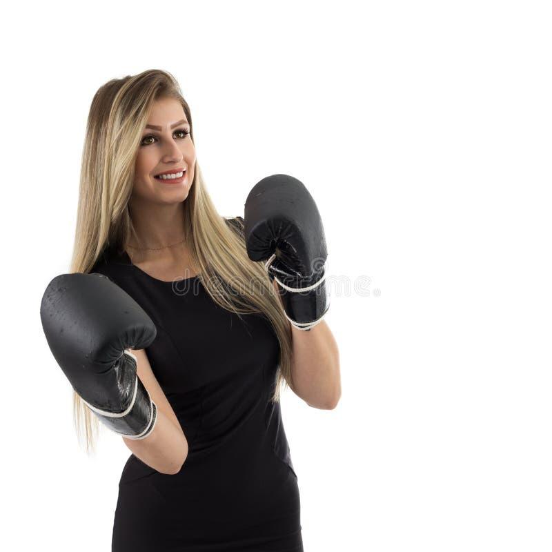 Luvas de encaixotamento desgastando da mulher de negócios A pessoa loura está vestindo o bl fotos de stock