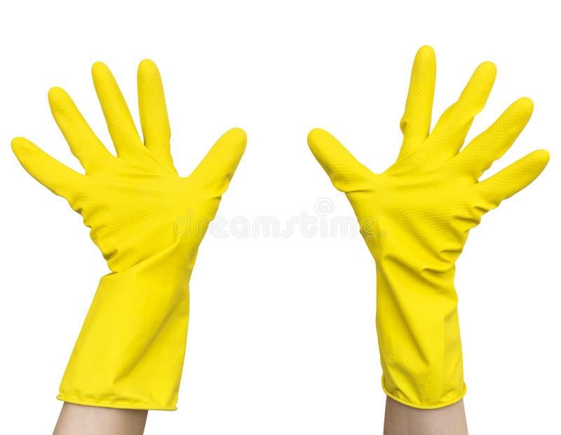 Luvas de limpeza do látex de borracha amarelo nas mãos fêmeas foto de stock
