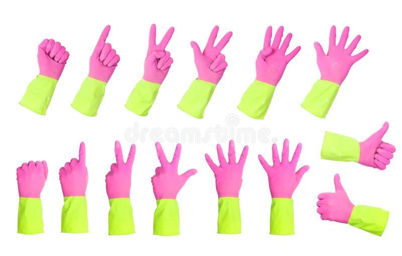 Luvas roxas/verde que gesticulam os números isolados fotografia de stock