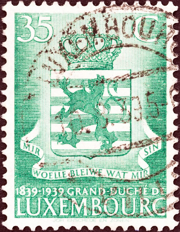 LUXEMBOURG - CIRCA 1939: A stamp printed in Luxembourg shows Arms of Luxembourg, circa 1939. royalty free stock photography