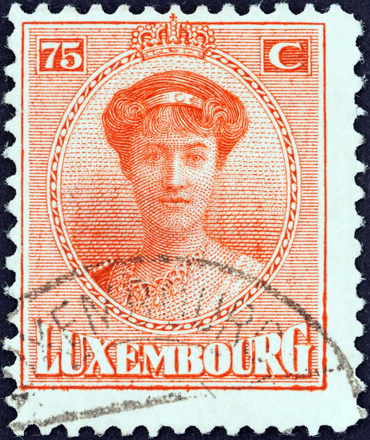 LUXEMBOURG - CIRCA 1921: A stamp printed in Luxembourg shows Grand Duchess Charlotte, circa 1921. royalty free stock image