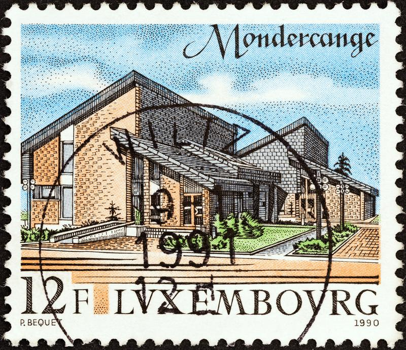 LUXEMBOURG - CIRCA 1990: A stamp printed in Luxembourg shows Mondercange administrative offices, circa 1990. stock images