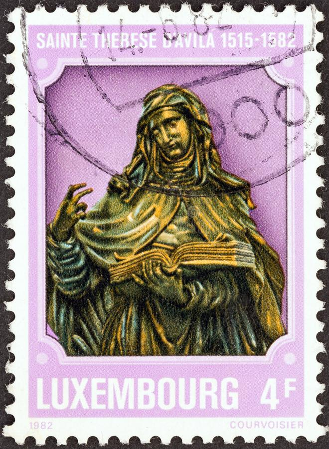 LUXEMBOURG - CIRCA 1982: A stamp printed in Luxembourg shows St. Theresa of Avila 1515- 1582, circa 1982. stock photography