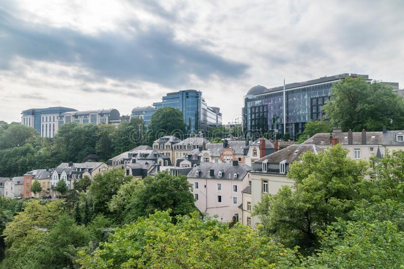 View of buildings next to tree-lined valley in Luxembourg stock photo