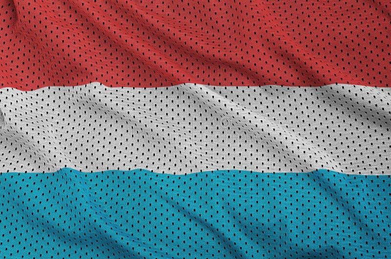 Luxembourg sjunker utskrivavet på ett fab ingrepp för polyesternylonsportswear arkivfoton