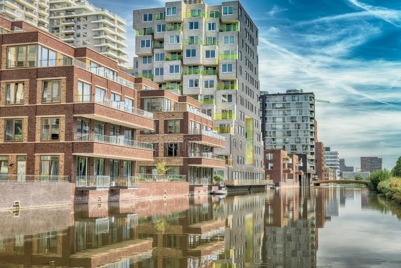 Luxery apartments, living, houses, Modern, reflection in the water, Zuidas in Amsterdam,. Amsterdam, George Gershwinlaan, The Netherlands, 08/23/2019, Modern royalty free stock images