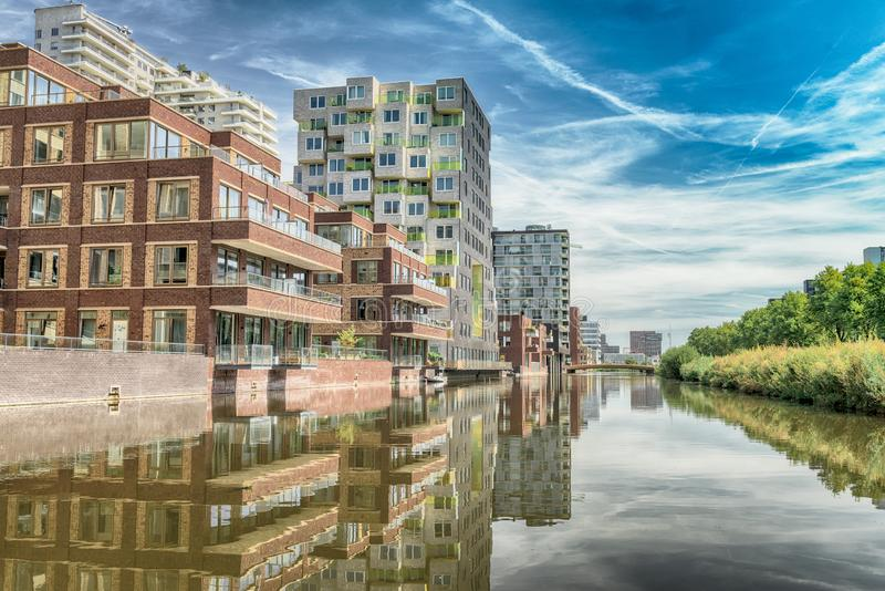 Luxery apartments, living, houses, Modern, reflection in the water, Zuidas in Amsterdam,. Amsterdam, George Gershwinlaan, The Netherlands, 08/23/2019, Modern stock photos