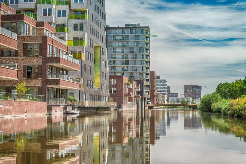 Luxery apartments, living, houses, Modern, reflection in the water, Zuidas in Amsterdam,. Amsterdam, George Gershwinlaan, The Netherlands, 08/23/2019, Modern royalty free stock photos