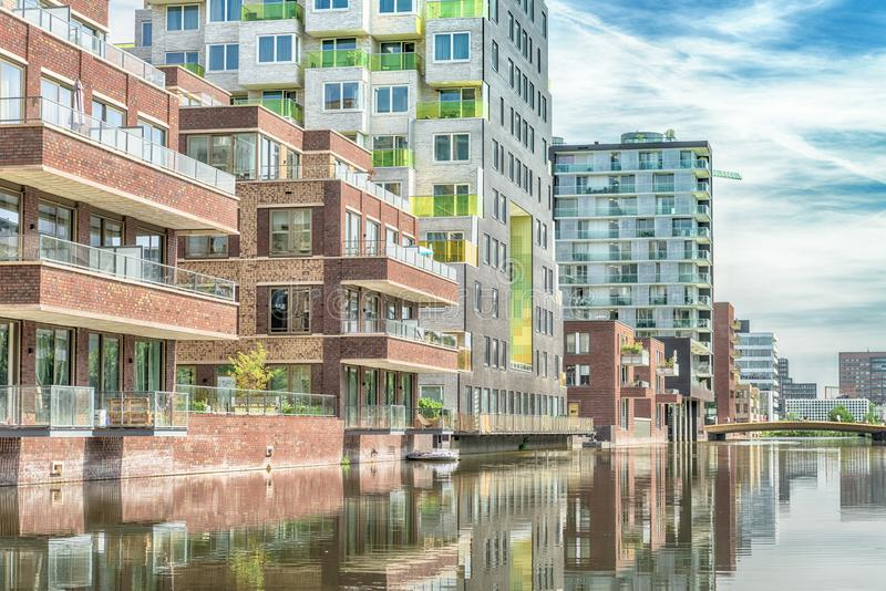 Luxery apartments, living, houses, Modern, reflection in the water, Zuidas in Amsterdam,. Amsterdam, George Gershwinlaan, The Netherlands, 08/23/2019, Modern stock photo