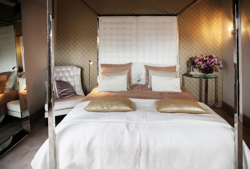 Luxery bed room. Detail of classic luxery bed royalty free stock photography