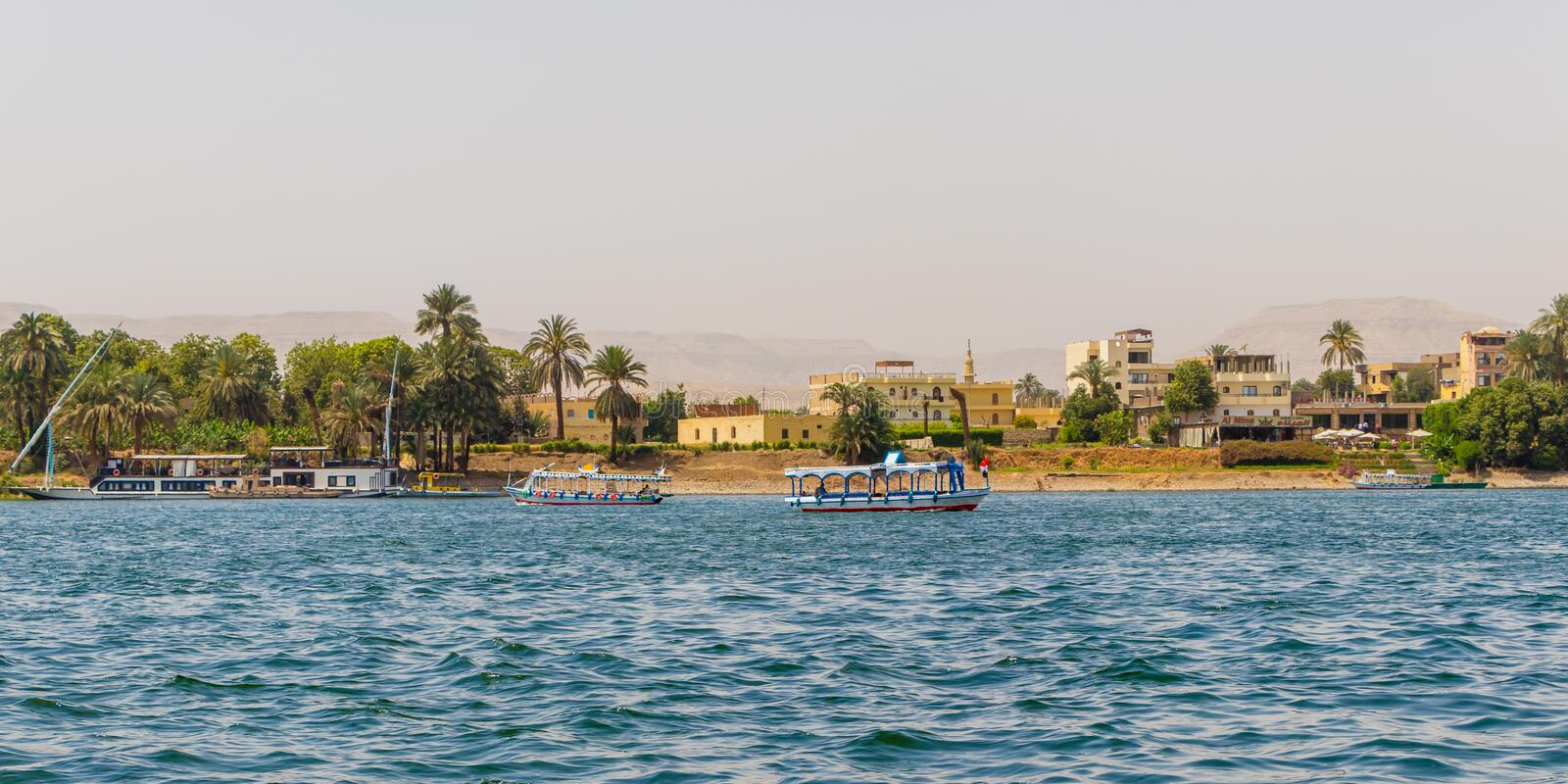 View of the Nile river town coastline with sailboats in Luxor, Egypt. Nile River is the longest river in the world, called the father of African rivers. It rises royalty free stock photo