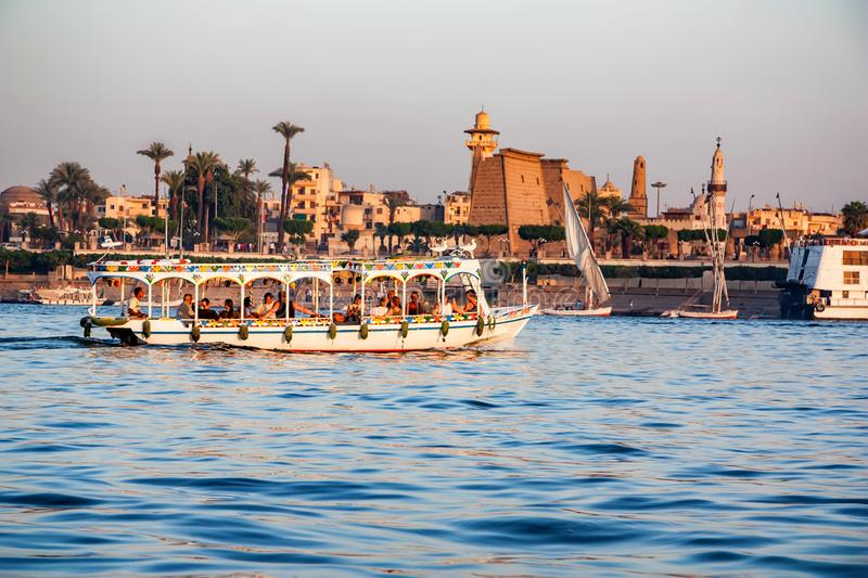 LUXOR, EGYPT - FEBRUARY 17, 2010: Tourist boat on Nile by Luxor city stock photography