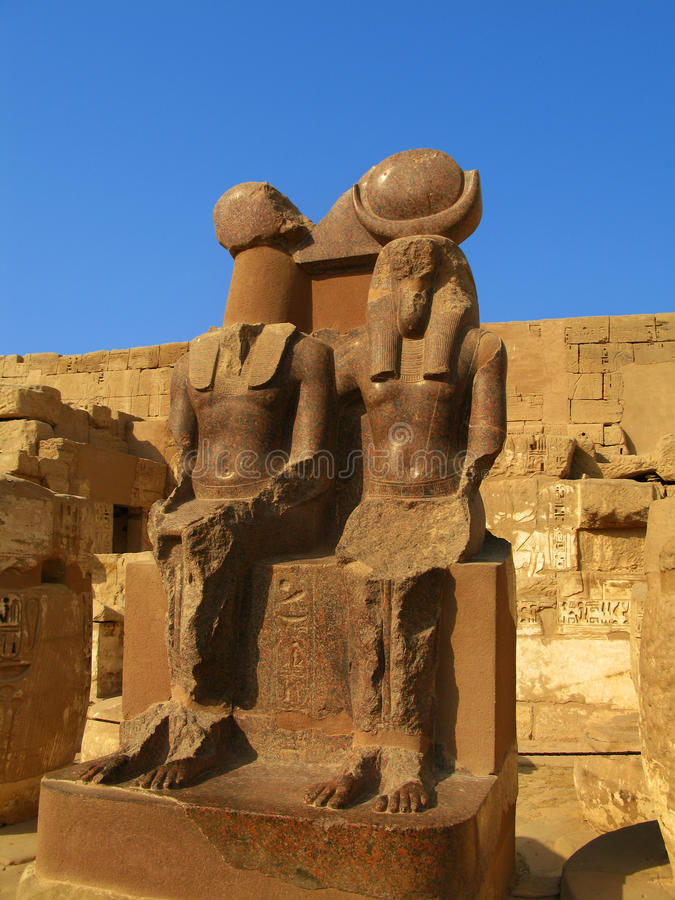 Luxor: granite statues at Medinet Habu temple. Luxor: Polished granite statue at the temple of Medinet Habu, dedicated to Rameses III. Luxor, Egypt stock photography