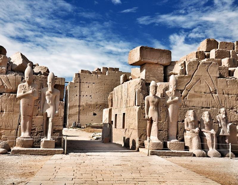 Luxor Karnak Temple, ancient Egyptian pharaoh sculptures. Karnak Temple is a large Ancient Egyptian temple on the east bank of the Nile River. Luxor, Egypt royalty free stock images
