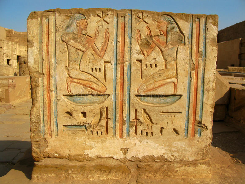 Luxor: Polychromed carvings at Medinet Habu temple. Luxor: Polychromed carvings at the temple of Medinet Habu, dedicated to Rameses III. West bank, Luxor, Egypt stock photos