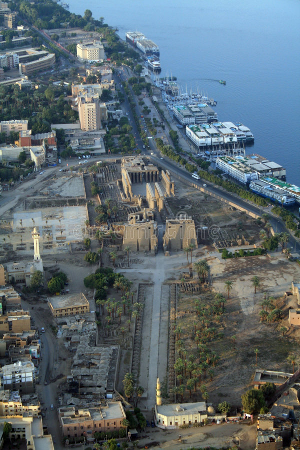 Luxor Temple and the River Nile - Aerial / Elevate. Luxor Temple is a large and significant Ancient Egyptian temple complex located on the east bank of the River royalty free stock photo