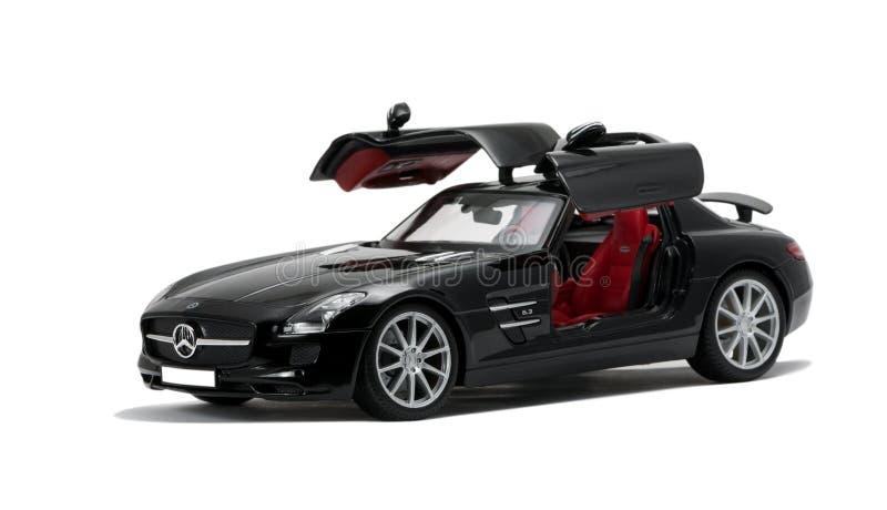 Luxueus zwart auto zijaanzicht royalty-vrije stock afbeeldingen