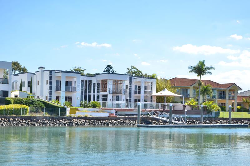 Luxuries houses along the river in Australia. With green palms trees royalty free stock photography
