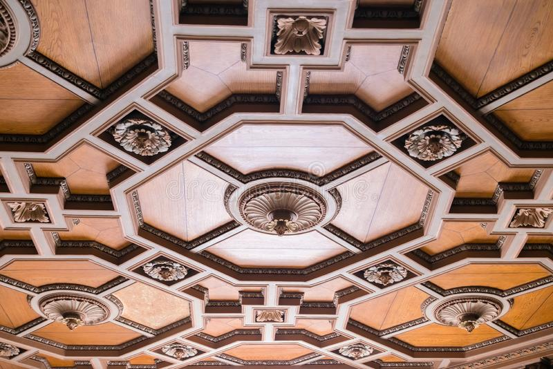 Luxurious antique wooden ceiling decorations in an old minor. Expensive geometric shapes made of hard wood.  royalty free stock photos