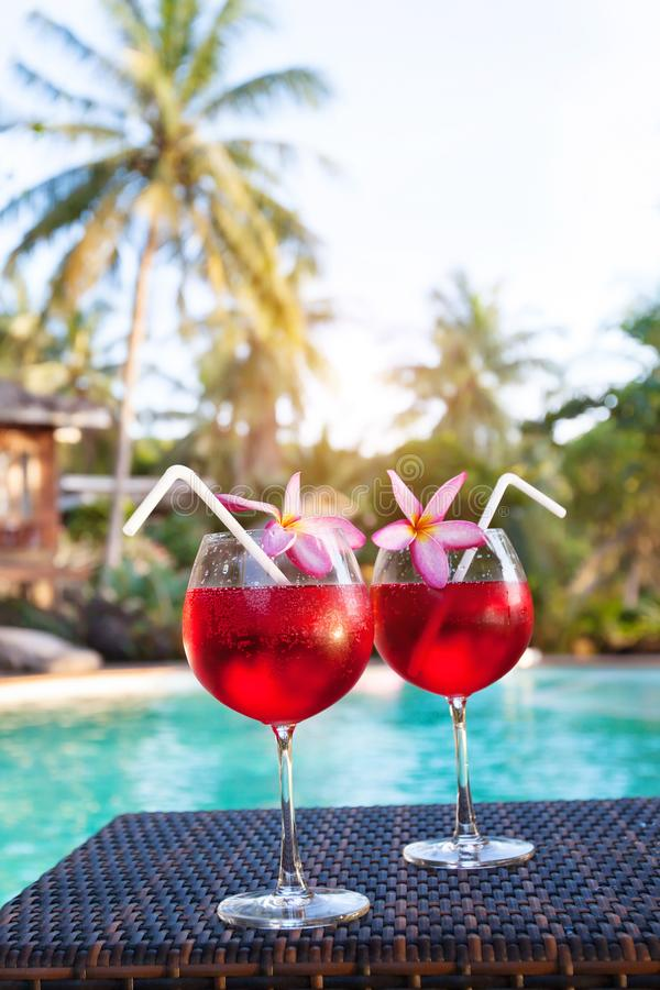 Luxurious beach hotel, two beautiful exotic cocktails near swimming pool, holidays stock photos