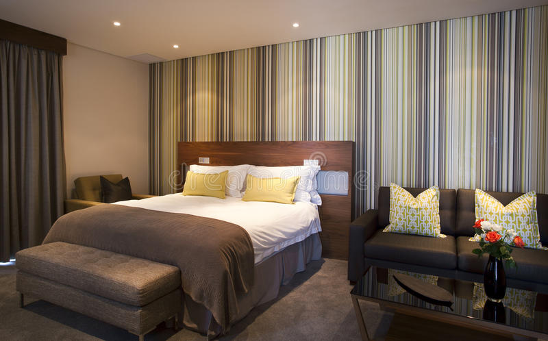 Luxurious Bedroom Suite. Classic bedroom suite with striking wallpaper to match stock photography