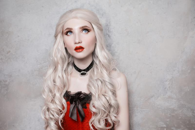 Luxurious blonde woman with beautiful long white hair stock photography