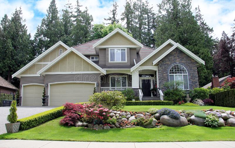 Luxurious Canadian mansion with a large professionally landscaped front yard stock photography