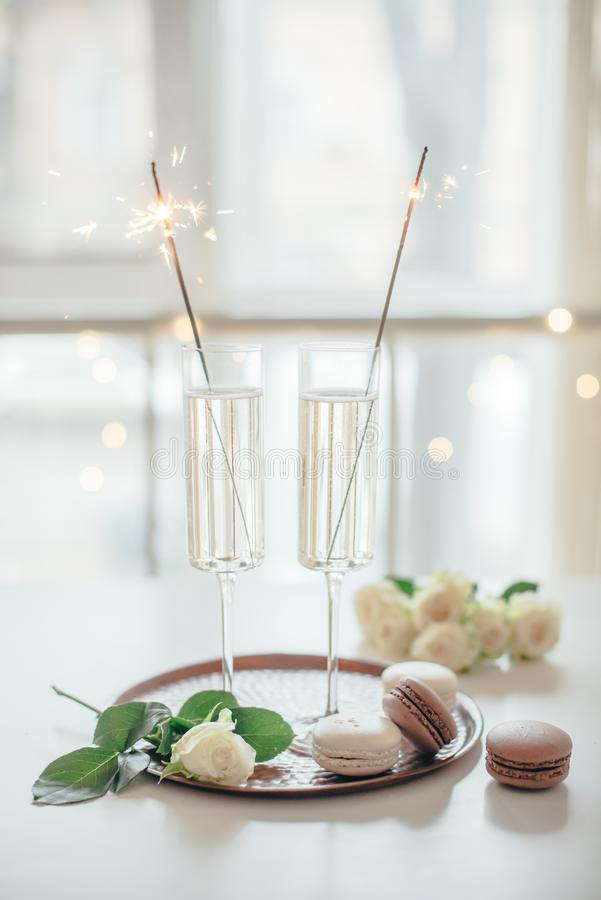 Luxurious champagne wedding party with white roses and macaron d. Esserts, holiday celebration with wine and sparklers stock image