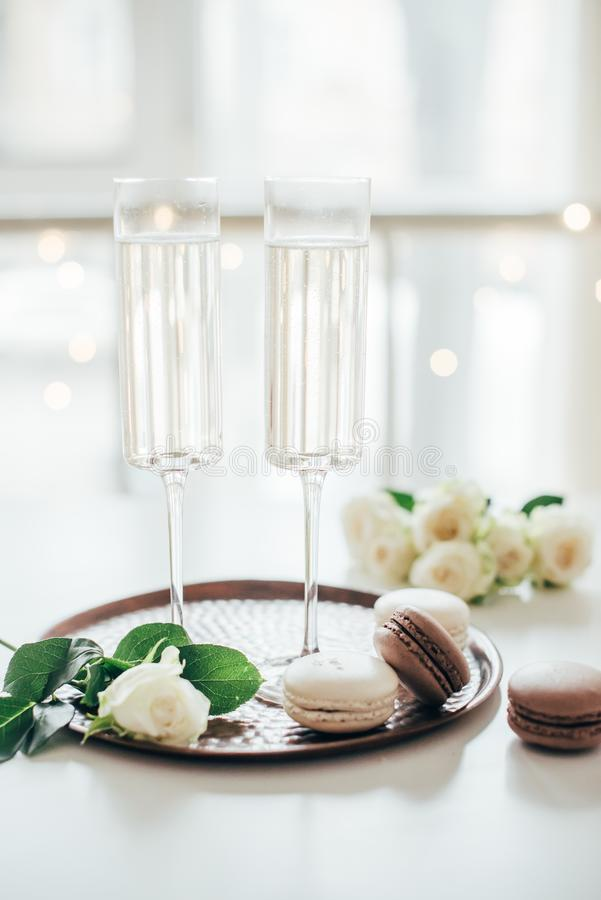 Luxurious champagne wedding party with white roses and macaron d. Esserts, holiday celebration with wine royalty free stock image