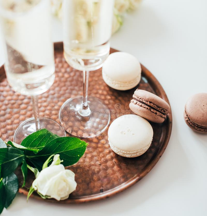 Luxurious champagne wedding party with white roses and macaron d. Esserts, holiday celebration with wine stock images