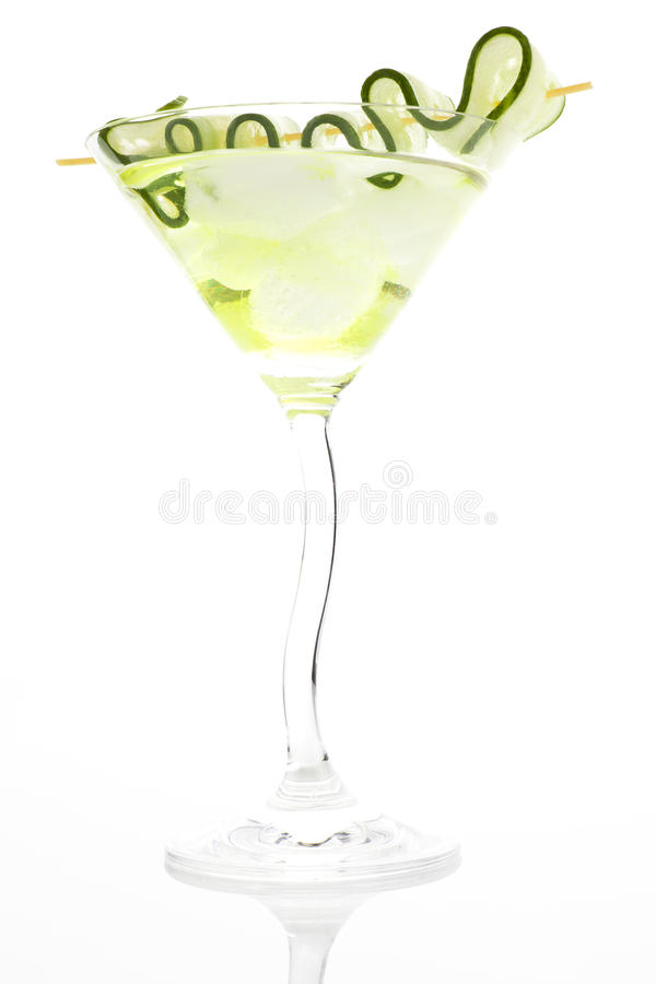 Luxurious cocktail with ice and cucumber garnish. Delicious cocktail with cucumber garnish on white background. Summer drink stock images