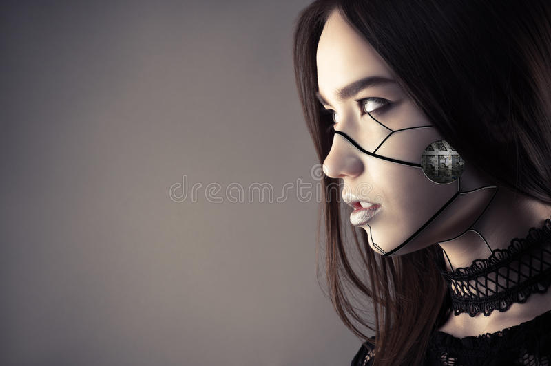 Luxurious cyberpunk girl with fashion makeup. Isolated on gray background stock photo