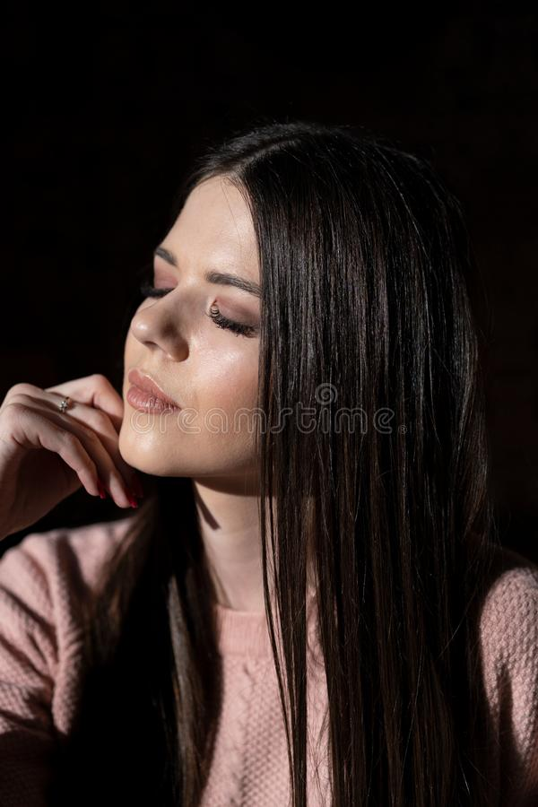 Luxurious dark hair. Beautiful young girl with closed eyes stock images