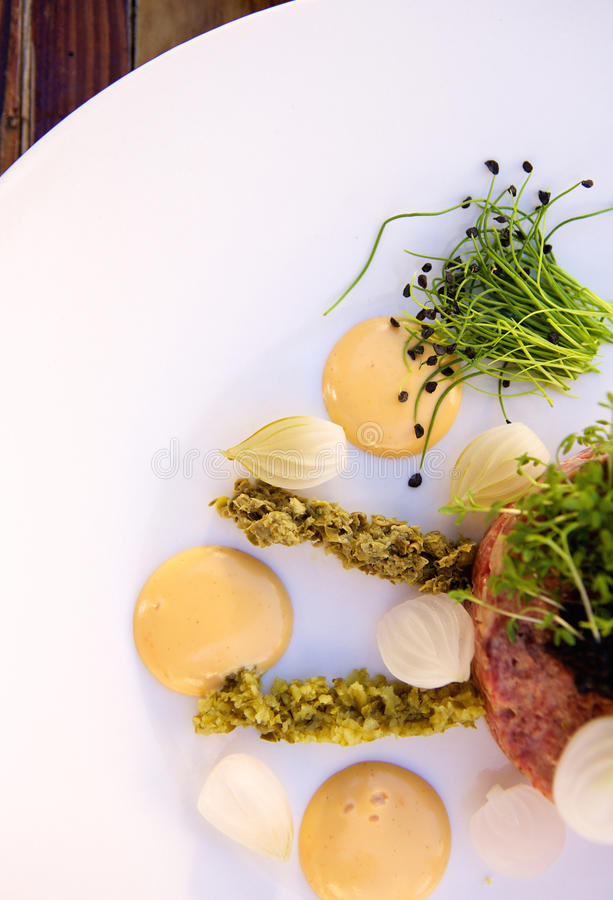 Luxurious food starter with caviar and steak tartare stock photography