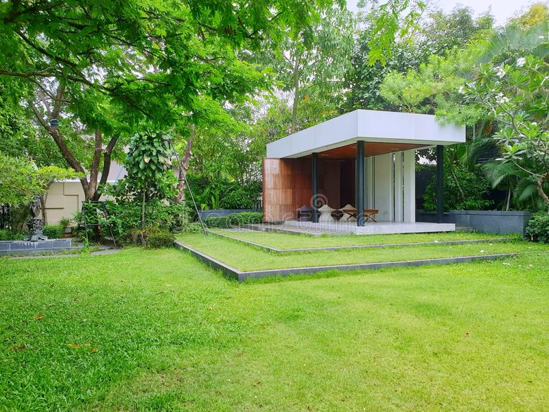 Luxurious garden for resting in the house area. Outdoors landscape garden, Backyard landscape stock photography