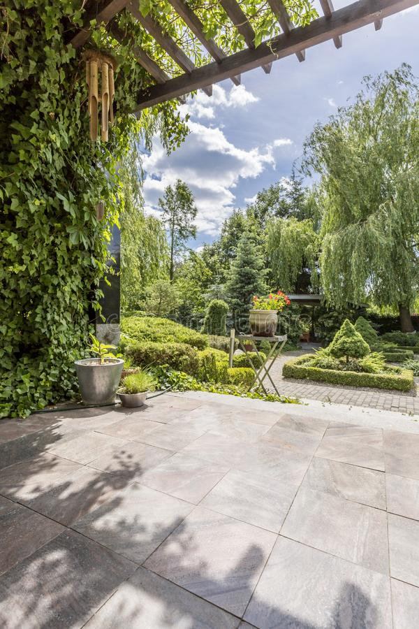 Luxurious garden with terrace and patio. Exterior view of a luxurious villa garden, terrace and patio royalty free stock photos