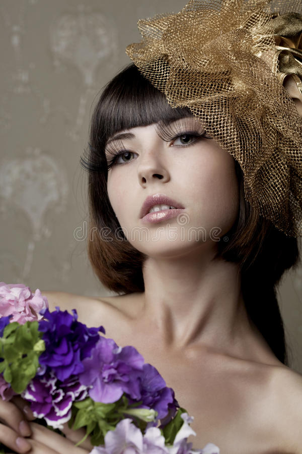 Luxurious girl with flowers in their hands royalty free stock image