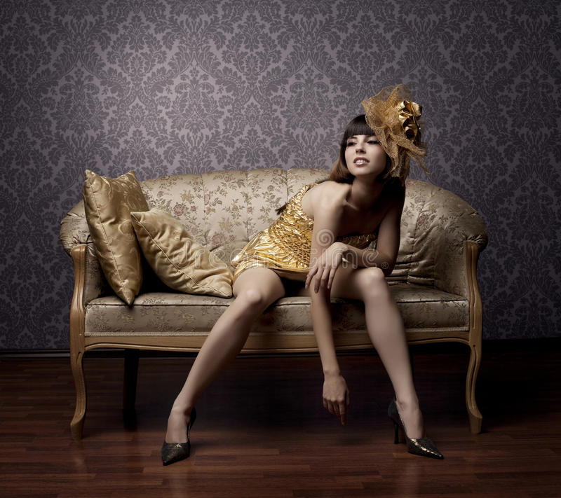 Luxurious glamorous models in gold royalty free stock photography