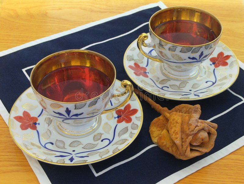 Luxurious gold tea cups stock photography