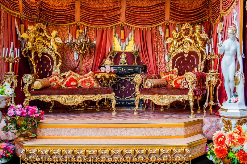 luxurious Golden Royal pompous Royal French Rococo interior, Russian throne royalty free stock photo