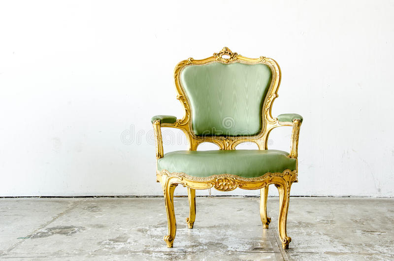 Luxurious green classical style Armchair sofa couch in vintage r. Luxurious green classical style Armchair sofa couch royalty free stock image