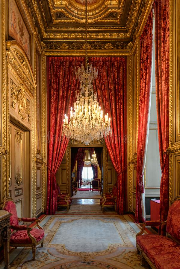 Luxurious Napoleon III apartments, Louvre museum, Paris France. Luxurious hallway or enfilade with chandeliers at the Napoleon III apartments located in the stock image