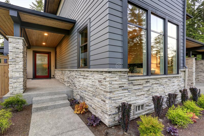 Luxurious home design with modern curb appeal in Bellevue. Luxurious new home with curb appeal. Trendy grey two-story exterior in Bellevue with large picture royalty free stock images
