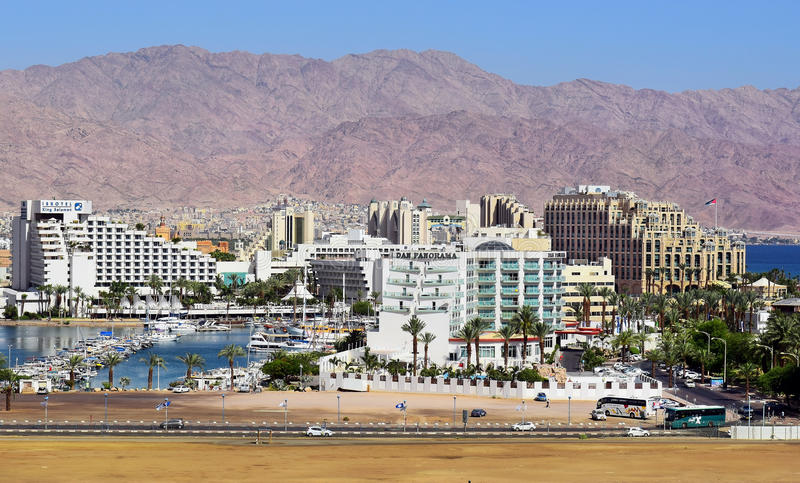 Luxurious hotels in popular resort - Eilat. Eilat, Israel - MAY 17 : marina and luxurious hotels in popular resort - Eilat of Israel on the background Jordanian stock images