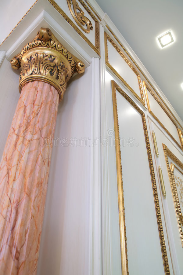 Luxurious interior with pillar. Fragment of the luxurious interior with pillar of rose marble stock photos