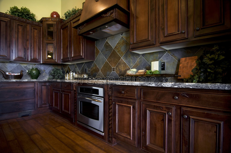 Luxurious kitchen with hard wood flooring royalty free stock photo